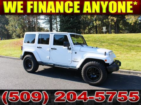 Pre-Owned 2014 Jeep Wrangler Unlimited Sahara 3.6L 4x4 leather+Nav+MT Tires